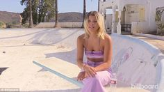 She's a pro: The model posed for the magazine on a diving board in a purple crop top and l...