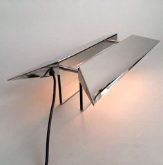 Gae Aulenti and Piero Castiglioni; Chromed Metal and Glass 'Pietra' Table Lamp for Fontana Arte, 1988.