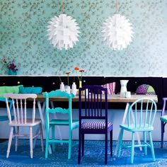 Refresh a collection of mismatched chairs by painting them in harmonising colours
