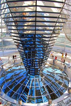"""Norman Foster, """"Reichstag Dome"""", 1999, a glass dome constructed on top of the rebuilt Reichstag building, symbolizing the reunification of Germany.  A mirrored cone in the center of the dome directs sunlight into the building, so that visitors can see the working of the chamber, Berlin, Germany."""