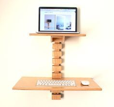 The Wall-Mounted Standing Desk is an adjustable, ergonomic, compact standing desk. It's designed to hold your laptop or tablet device at the height of your eyes