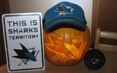 Jay displays his accessorized #Sharkoween pumpkin.
