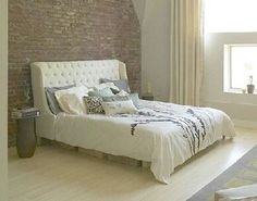 exposed brick wall bedroom   I have this exact bead spread - I like it here better.