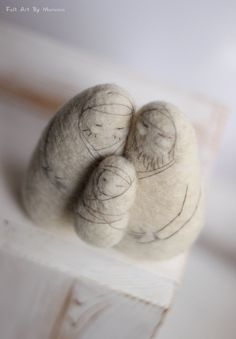 Joseph, Mary and baby Jesus are made of natural white wool. They are sewn together, to keep them as composition.  12 cm high/FeltArtByMariana