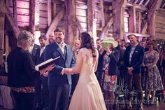 Groom smiles during wedding ceremony. Photography by one thousand words wedding photographers