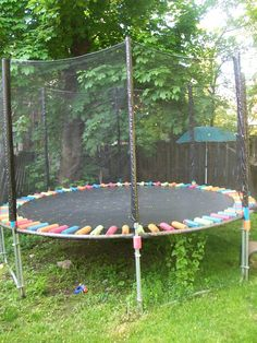 Pimp Your...trampoline! So, I've had this awesome trampoline for nearly three summers now. Rather than purchase a replacement pad when the old one wore out, I upcycled  pool noodles to create protection for wayward heads.