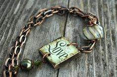 I love the combo of green and antique copper. The use of a scrabble tile in a bracelet is inspiring. Domino Jewelry, Mixed Media Jewelry, Metal Jewelry, Scrabble Tile Jewelry, Scrabble Tiles, Handmade Jewelry Designs, Homemade Jewelry, Jewelry Bracelets, Jewlery