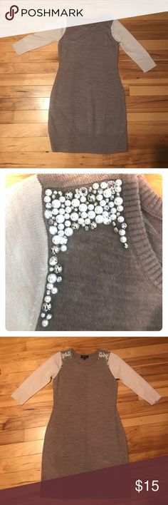 Sweater dress Re-Posh. EUC. I don't see any flaws on this. Mid length light purple dress with cream sleeves and embellished pearl/sparkles on shoulders. BCX Dresses