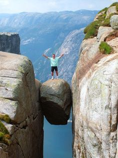 Kjeragbolten boulder mountains in Norway--I might like to go here, but would I do this? NEVER