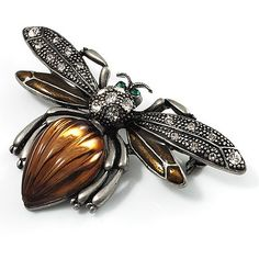 $18.92 A quirky little adornment for your outfits, this Vintage Diamante Bee Brooch is just adorable. Featuring a large bee design, crafted in antique silver finish and decorated with sparkling clear crystals and chocolate coloured enamel detailing on the wings. The body set with a resin textured stone in hues of dark brown, providing a unique style. The eyes encrusted with two small emerald green stones...