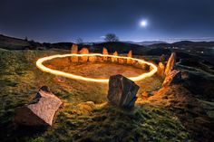 This is the Ballymacdermot Cairn located in Co Armagh, Northern Ireland.        This monument, lying on the slopes of Ballymacdermot Mountain close to Newry, is an extremely well preserved Neolithic burial site with three chambers. It can be dated between 4000 and 2500 BC. Locally known as The Fairy Ring. Capture here under full moon with a ring of Fire by means of oil lantern.