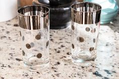 Very cool, retro pair of mid century silver banded and polka dot high ball glasses, perfect for your Mad Men-style barware collection.