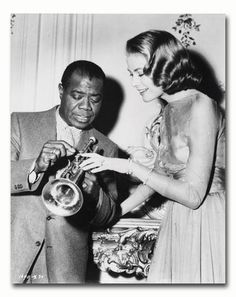 Grace Kelly as Tracy Samantha Lord, Louis Armstrong as Himself from High Society 1956