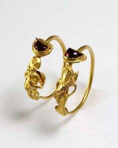 A Pair of Gold & Garnet Earrings of Eros, Hellenistic Period, ca 2nd - 1st…