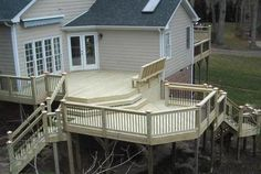 I love multi level decks...this one is elevated high enough that I'd add a third tier jutting out from the closest corner wall with no steps leading to the ground, its just a third section seating area, possibly with a fire pit...