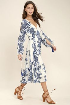 Lulus Exclusive! The Boat Life Blue and White Print Midi Dress is an al fresco favorite! Gauzy woven rayon with an allover blue and white paisley-inspired print shapes a V-neckline and long, cold shoulder bell sleeves (with tying cuffs). High, arching waist gives way to a full midi skirt.