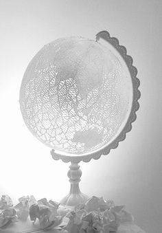 lace globe from writtenafterwards. lovely. so many ideas for globes just popped in my head after seeing this. hmmm...