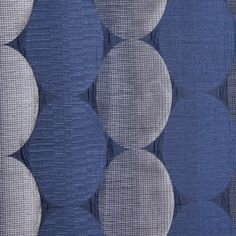Use this satiny polyester home fabric in places where you want a modern, slightly retro touch. Six-inch ovals in alternating smooth and raised textures. Subtle sheen and satiny feel. This fabric is perfect for bedding, light upholstery, window treatments and accent pieces.