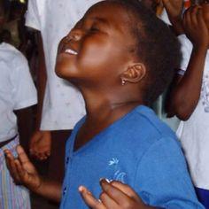 Iris-Village of Joy- baby worshipping Jesus in Pemba, Mozambique,Africa. Precious!
