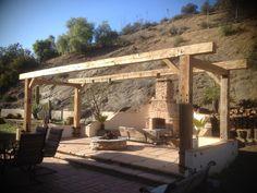Reclaimed Barn wood beams make a stunning pergola.