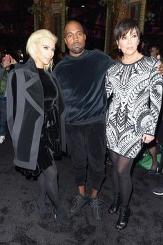 Kim Kardashian, Kanye West, and Kris Jenner attend the Balmain show during Paris Fashion Week on March 5, 2015. - Cosmopolitan.com