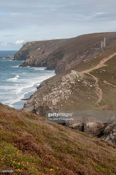 The coast near Chapel Porth, Cornwall with the ruins of the Wheal Coates Tin mine on the cliffs in the distance. Tin Mine Cornwall, England Map, Royalty Free Images, Distance, Coast, Stock Photos, Water, Outdoor, Gripe Water