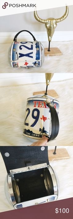 License Plate Purse Super unique purse made of a  Texas license plate. Used once as a purse and had mainly been a decoration ever since! In excellent condition! Snap closure. This is only really big enough to hold a wallet, keys and a few other things. Little Earth Bags Mini Bags