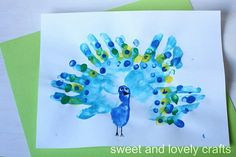 Create this colorful peacock using your little one's hand prints!