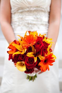A bold bouquet of reds, oranges and yellows (Daniel Taylor Photography)  My ideal bouquet!!!! This is what I've been looking for.