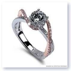 Entwine yourself in this wispy two tone 18K polished white and rose gold engagement ring. A halo of brilliant diamonds encircle the center stone while diamond laced strands rise and twist to meet. Vallarta Diamond Engagement Ring Style 2002-18kwr http://www.msimagines.com/product-p/2002-18kwr-wpd.htm