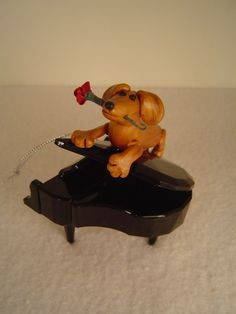 Red dox on a piano with rose 2