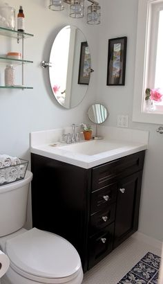 That's The Home Depot's Gato Cafe Mirror seen in this small bathroom remodel by Melissa, who writes the blog Top It Off With Mel. || @melstarr13
