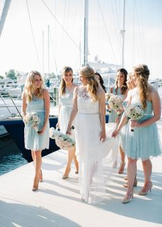 The bridesmaid walking with the bride picture taken at The Resort at Longboat Key Club Marina.