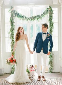 Stunning DIY wedding arches. Her wedding gown and his suit are also stunning!