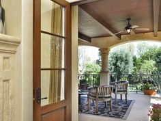 This master suite's balcony features vaulted ceilings and a beautiful veranda overlooking the lush gardens and beautiful Tuscan style olive trees surrounding the property. 5252 Amestoy Ave   Amestoy Estates