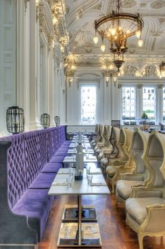 paris hotel, lovely ceiling, dark lavender bench seating and über cool cream chairs.