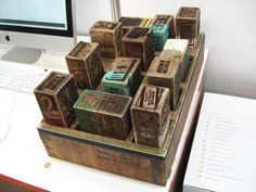Kudzai Dyirakumunda attempted to tackle the topic of the London riots using messages about the events that had been posted on Twitter. Some were etched into News Blocks presented in a wooden tray, giving permanence to these digital communications
