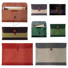 Postalco series of document carrying envelopes made from pressed cotton and leather with an adjustable button closure.