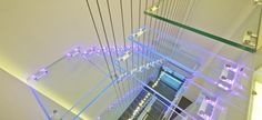 Astonishing Luxurious Penthouse Design for Modern Living: Fantastic Staircase Design Used Glass Material Decorated With LED Lighting Design ...