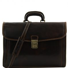 Dark brown italian leather briefcase. Polished calf-skin leatherNatural liningBack compartment with YKK metal zipFlapFront side compartmentRigid leather handleRigid structureInside 2 compartments -