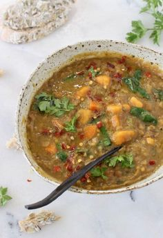 Bowl of Moroccan Sweet Potato Lentil Stew recipe with cumin, coriander and smoked paprika.