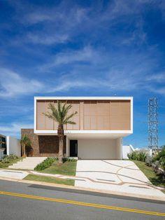 Projeto de Casa elaborado pela 24.7 Arquitetura Design no condomínio Sainte Helene. Projeto sustentável e moderno criado por nossos arquitetos.