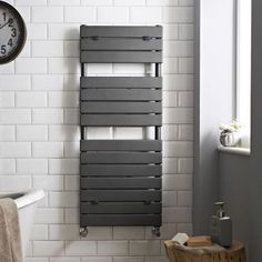 The Hudson Reed flat panel heated towel rail features a contemporary anthracite finish