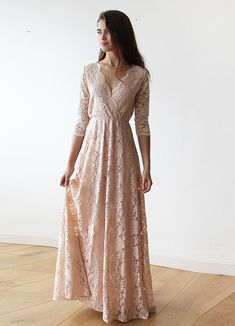 Blush-pink gown with lace bodice and three quarters sleeves. The dress has a modest yet vintage style, floor-length hemline, delicate v-neck, and is carefully crafted using the finest soft lace. A refined and classic fit designed for style, comfort Blush Pink Maxi Dress, Pink Gowns, Blush Dresses, Blush Rose, Long Sleeve Lace Gown, Look Rose, Moda Boho, Boho Dress, Dress Lace