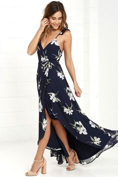You'll find everything you're looking for, and more with the All Mine Navy Blue Floral Print High-Low Wrap Dress! Breezy chiffon with a cream, periwinkle, and green floral print sweeps over a strappy, ruffled wrap bodice with tying waist. High-low skirt with front slit.