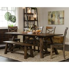 Inspired by classic American furniture, this unique handmade dining table is the perfect centerpiece to any stylish dining room. Acacia wood finished, this piece is a sturdy and dependable asset to yo