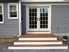Steps to Patio Back Door | We recently finished the steps and deck above. The decking is Fiberon ...