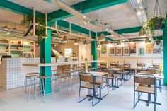 green columns and beams, plants, tiles, heraklith ceiling, 400 rabbits pizza restaurant