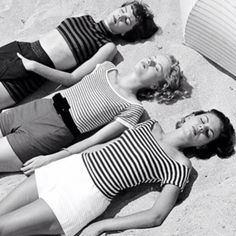 1950s stripes on a beach. summer holidays alone will call for warm weather wear like this