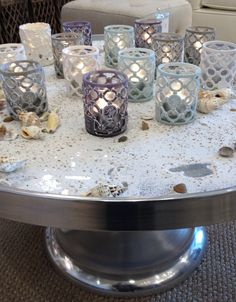 Perfect for under the veranda! Tray with different sized candles or votives!